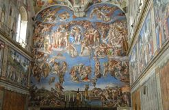 The Last Judgment in the Sistine Chapel in Rome, Italy. Photo made at the Sistine Chapel in the Vatican Museums in Rome in Italy. In the picture you see three Royalty Free Stock Images