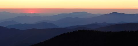 Last Light from Clingman's Dome Panorama. The last light of the setting sun, seen from the side of Clingman's Dome in the Smoky Mountains Nat. Park, USA.  A Royalty Free Stock Image