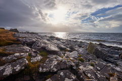 Last light over a remote rocky beach. Royalty Free Stock Photography