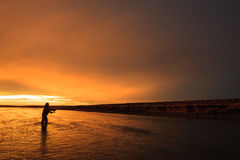 Last light in Patagonia. Last cast before dinner on RIo Gallegos, Patagonia, Argentina Royalty Free Stock Photos
