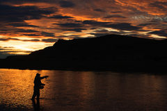 Last light in Patagonia. Last cast before dinner on RIo Gallegos, Patagonia, Argentina Stock Image