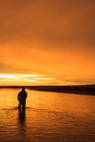 Last light in Patagonia. Last cast before dinner on RIo Gallegos, Patagonia, Argentina Royalty Free Stock Images