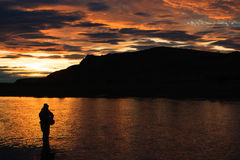 Last light in Patagonia. Last cast before dinner on RIo Gallegos, Patagonia, Argentina Royalty Free Stock Image