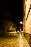 Last light standing. Long exposure picture of a stone street taken at night Stock Photo