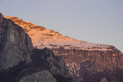 Last lights of the sunset. Snowy mountain crest illuminated by sunset light stock images
