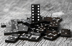 Last man standing one most valuable domino leader Royalty Free Stock Image