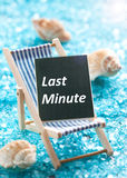 Last minute. Concept with deck chair royalty free stock image