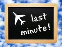 Last Minute chalkboard. Chalkboard or blackboard with words Last Minute stock image
