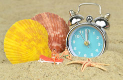 Last minute holiday. Concept with clock on the beach Royalty Free Stock Photography