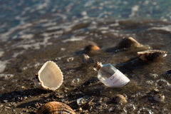 Last minute offers. Last minute message in a bottle on beautiful beach royalty free stock images