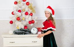 Last minute till midnight. New year countdown. Last minute new years eve plans that are actually lot of fun. Girl kid. Santa hat costume with clock counting stock image