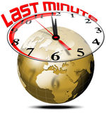 Last minute travel. Gilded globe with clock and writing last minute Royalty Free Stock Image