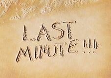 Last minute. Word written on beach sand royalty free illustration