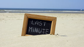 Last minute written. On a chalkboard at the beach Stock Images