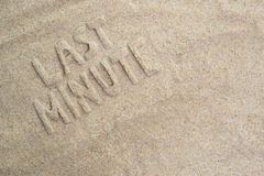 Last minute. Written in sand on beach. holiday theme background concept Stock Photo