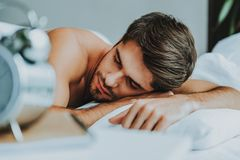 Handsome young man have to wake up royalty free stock photo