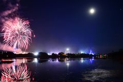 The Last Night at the 2018 Isle of Wight Festival Fireworks. Fireworks, lights and a near full `strawberry` moon reflect off the River Medina on the last night Royalty Free Stock Image