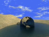 The last oasis. The thirsty globe in a puddle of water - 3d rendering Stock Photography