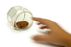 The Last One. A hand in blur-motion reaching for the last cookie in the jar. This image is about control, greed and temptation royalty free stock photo