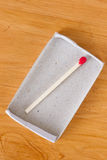 Last one matchstick in box stock photography
