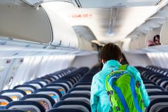 Last passenger, young adult woman leaving an airplane stock photo