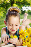 Girl picking petals Royalty Free Stock Photography