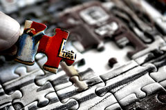 The last piece. Inserting the final piece in a jigsaw puzzle Stock Images