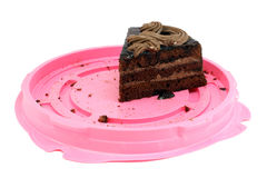 Last piece of chocolate cake. Last piece of chocolate sponge cake on pink substrate Stock Photo