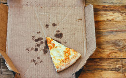 Last piece of fresh pizza four cheeses Royalty Free Stock Photography
