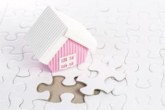 Last piece of jigsaw build your home Royalty Free Stock Photography