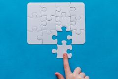 Last piece jigsaw in hand,Concept success of business. stock photo
