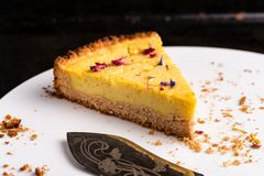 Last piece of a vegan lemon cheesecake - horizontal royalty free stock photo