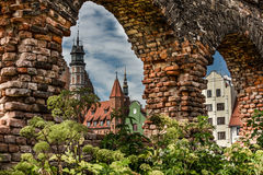 Last post war remains in Gdansk, Danzig, Poland. View through ruins to the old town. Royalty Free Stock Photography