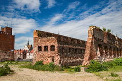 Last post war remains in Gdansk, Danzig, Poland. View through ruins to the old town. Royalty Free Stock Photo
