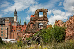Last post war remains in Gdansk, Danzig, Poland. View through ruins to the old town. Royalty Free Stock Photos