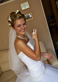 The last preparing for wedding. Portrait of young smiling bride preparing for wedding Royalty Free Stock Images