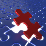 Last puzzle piece. Fitting the last piece of a puzzle as concept for achievement or success Stock Photos