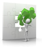 The last puzzle piece - solution. 3d character lifts last jigsaw piece into place - 3d illustration/render Royalty Free Stock Photography