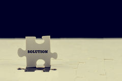Last puzzle piece with the word - Solution Royalty Free Stock Image