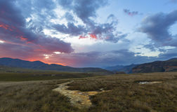 The last rays of the sun colour the clouds. South Africa Stock Photo