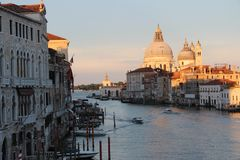 The last rays of the sun before the Venetian night. The last rays of the sun fell from the walls of Venice saturated with age-old history Royalty Free Stock Photo