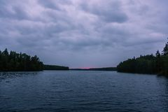 The last rays of the sun late in the evening over a small forest lake in Karelia. Russia stock image