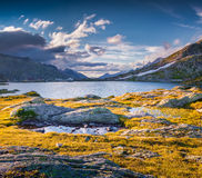 The last rays of the sun over Totensee lake on the top of Grimse Stock Photo