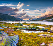 The last rays of the sun over Totensee lake on the top of Grimse Stock Photography