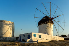 The last rays of the sun over White windmills on the island of Mykonos, Greece. The last rays of the sun over White windmills on the island of Mykonos, Cyclades Stock Photo