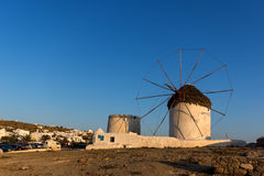 The last rays of the sun over White windmills on the island of Mykonos, Greece. The last rays of the sun over White windmills on the island of Mykonos, Cyclades Stock Image