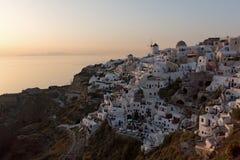 Last rays of sun in town of Oia, Santorini island, Thira, Greece Royalty Free Stock Image