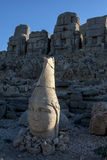 The last rays of sunshine hit the statue of Antichos on the eastern platform at Mt Nemrut in Turkey. Stock Image