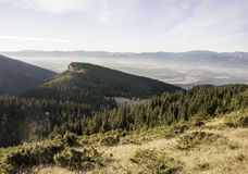 Last rays touch the high mountains in autumn Stock Photography