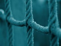 Last Resort. Climbing net of knot ropes blue coloured stands for the last resort Royalty Free Stock Image